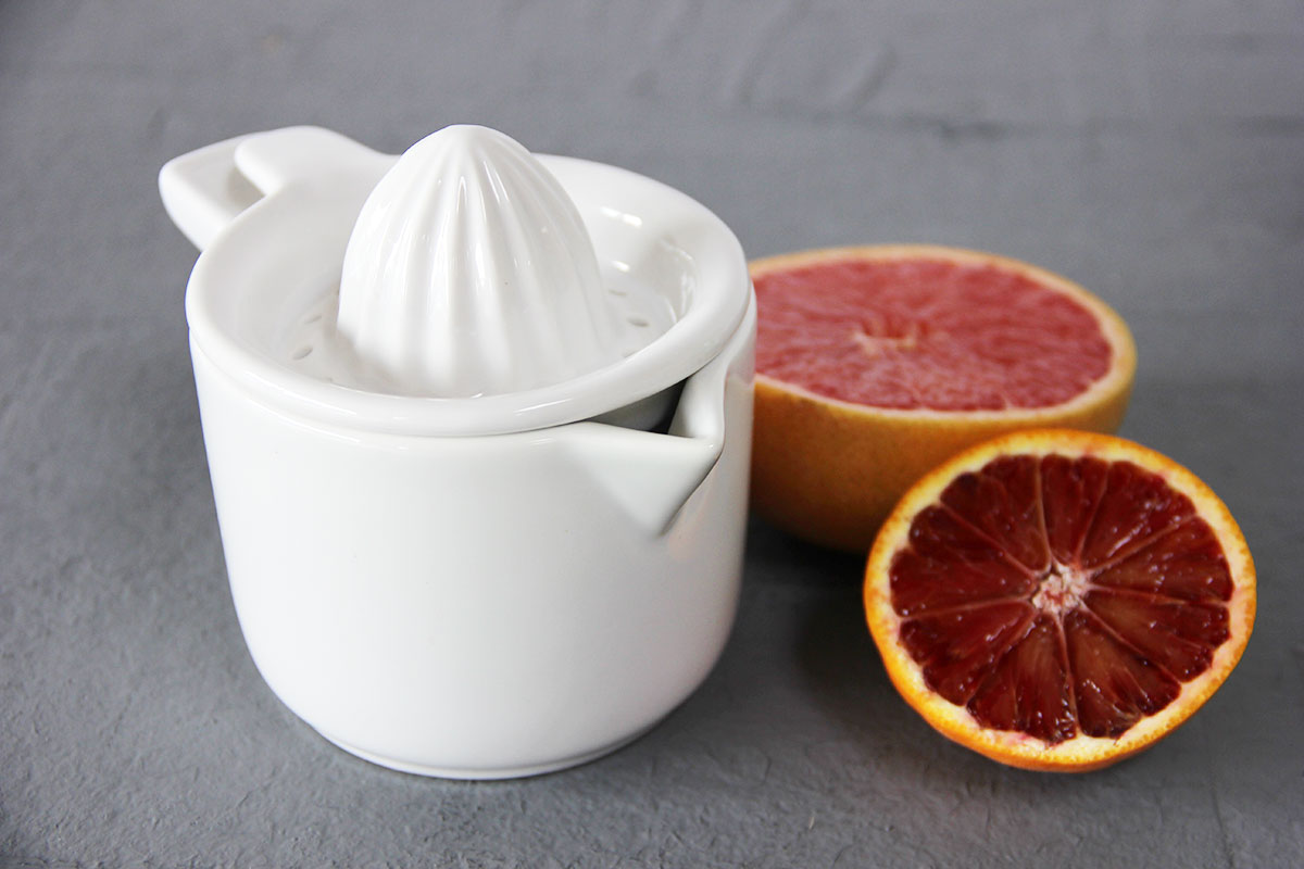 White juicer and grapefruit and blood orange