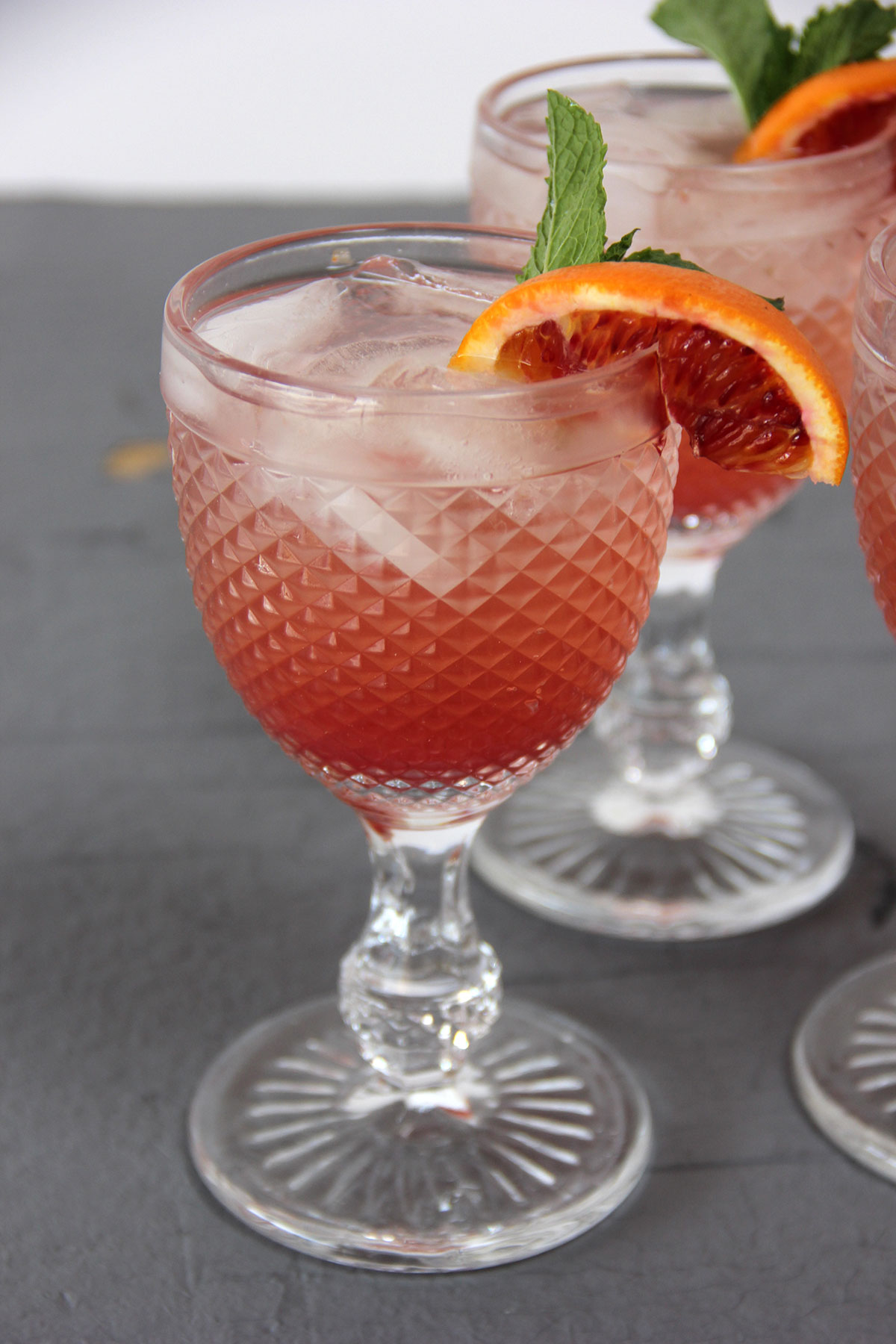 Grapefruit blood orange spritzer with mint garnish