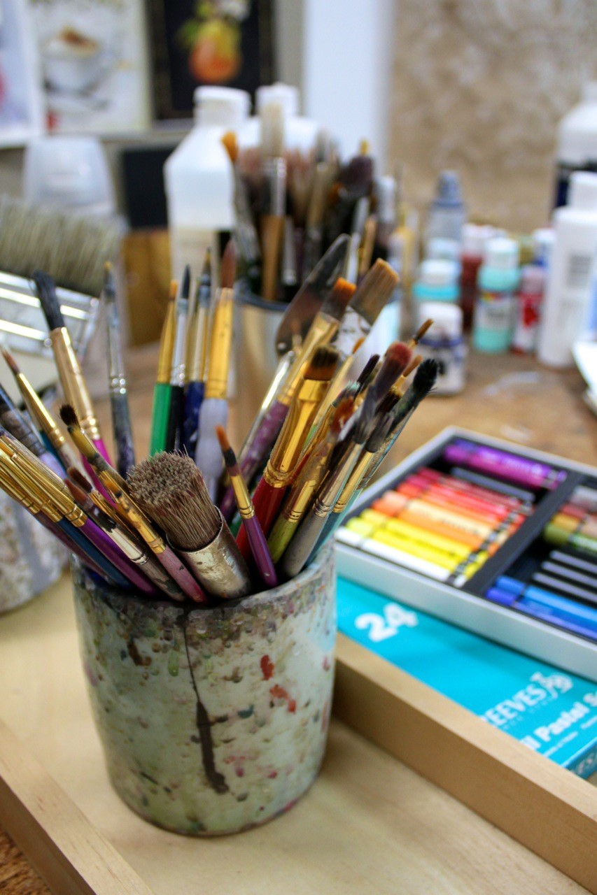 Artist interview with Chad Barrett for Creative Co-Op in the studio paint brushes in a cup.
