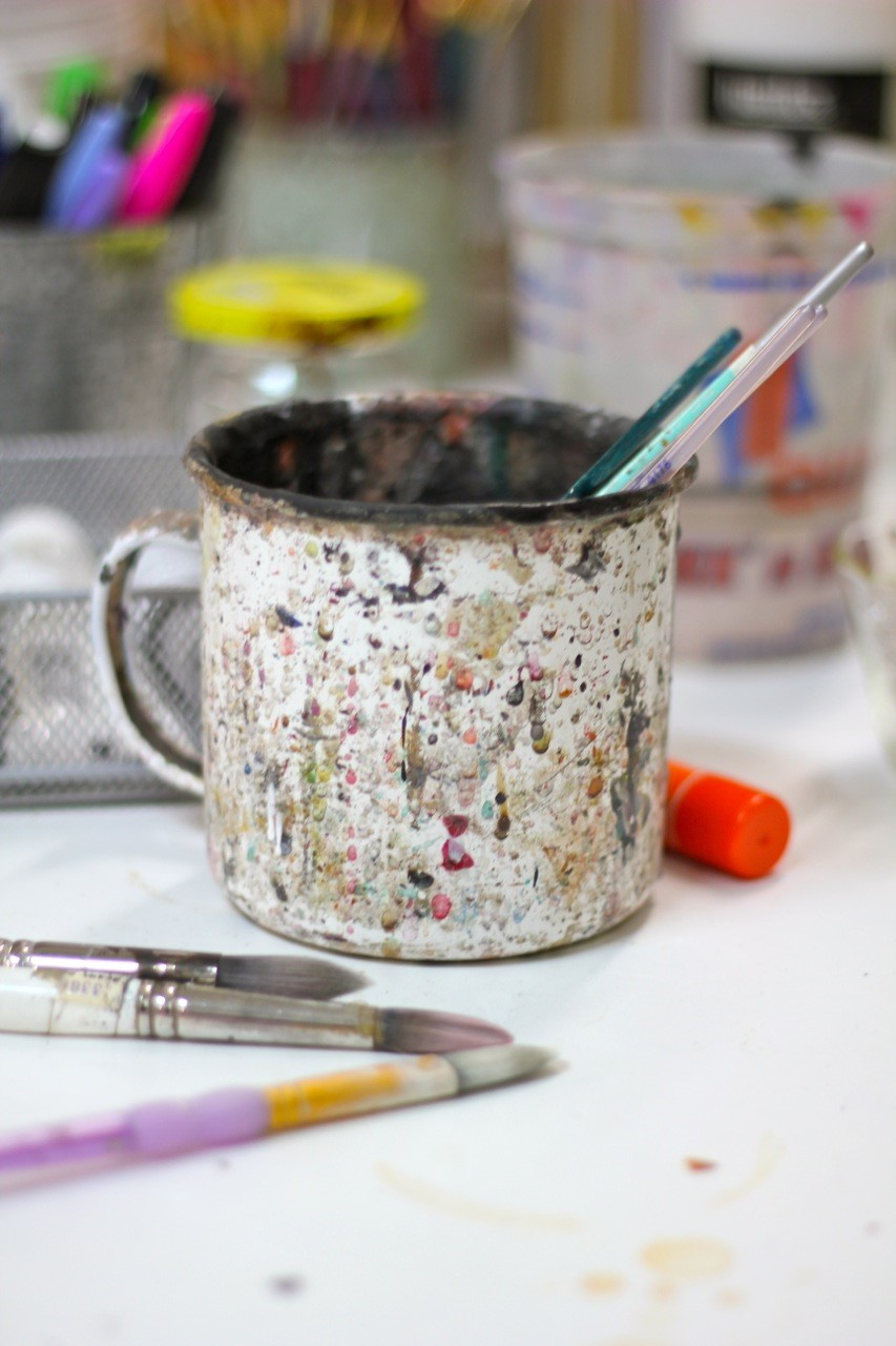 Artist interview with Chad Barrett for Creative Co-Op in the studio with paint cup.