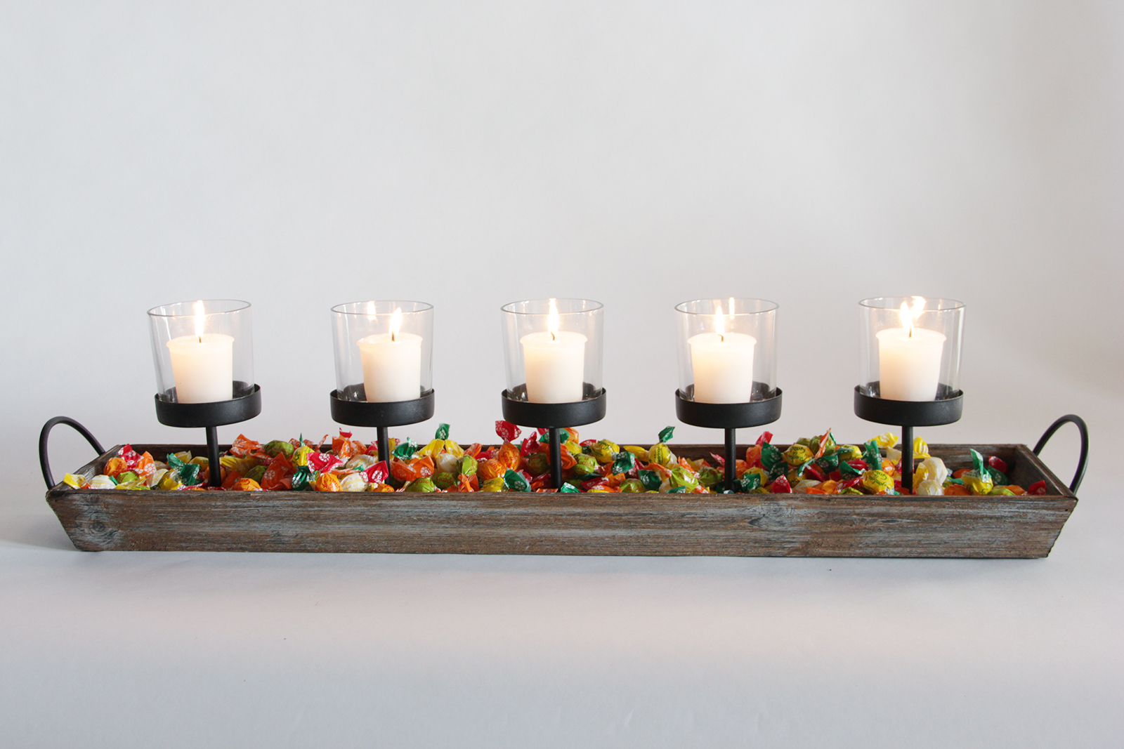 votive holder with candy and candles